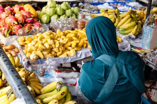 muslim merchant selling fruits